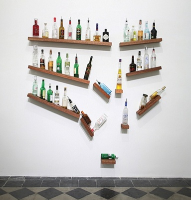 and the wild card a broken liquor shelf art piece by james hopkins